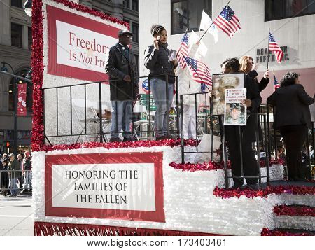 NEW YORK - 11 NOV 2016: Gold Star families ride on a parade float in the annual Americas Parade up 5th Avenue on Veterans Day in Manhattan.