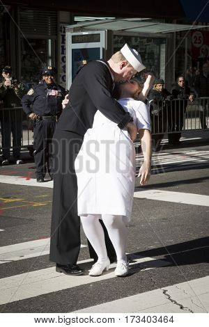 NEW YORK - 11 NOV 2016: Theresa Werner and James Martin from Keep The Spirit of 45 Alive group re-enacts the famous Times Square Kiss at the annual Americas Parade up 5th Ave, Veterans Day, Manhattan.