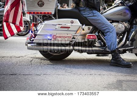 NEW YORK - 11 NOV 2016: A vet and member of the New York Fire Department, FDNY, rides on a motorcycle in the annual Americas Parade up 5th Avenue on Veterans Day in Manhattan.