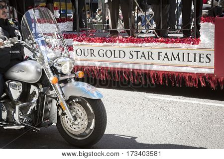 NEW YORK - 11 NOV 2016: Gold Star families ride on a parade float with a motorcycle escort in the annual Americas Parade up 5th Avenue on Veterans Day in Manhattan.