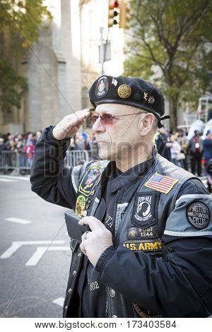 NEW YORK - 11 NOV 2016: US Army vet salutes as bikers on motorcycles participate in the annual Americas Parade up 5th Avenue on Veterans Day in Manhattan.