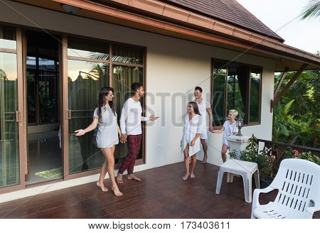 Young People Group On Terrace Tropical Hotel, Friends Tropic Holiday Vacation Green Forest