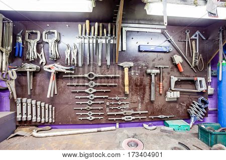 in a workshop of metal this old workbench