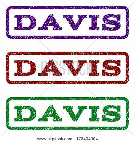 Davis watermark stamp. Text caption inside rounded rectangle frame with grunge design style. Vector variants are indigo blue red green ink colors. Rubber seal stamp with dust texture.