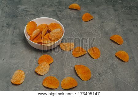 potato chips on a gray concrete background