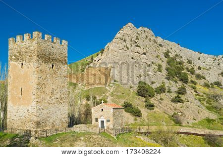 Tower Federico Astaguerra and Church of the 12 apostles near the ancient Genoese fortress in Sudak Crimea Ukraine.