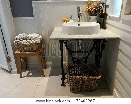 White Sink on marble and napkin basket in bathroom at restaurant, washstand bathroom in hotel, classical washbasins.