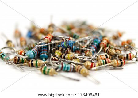 Used resistors with different values on a white background closeup