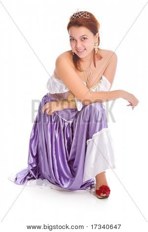 Young smiley woman sitting in ball dress