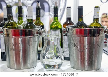 BELGRADE SERBIA - FEBRUARY 25 2017: Bottles of wine from Skovin winery ready for tasting during the 2017 Belgrade wine fair