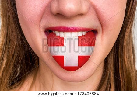 Woman With Swiss Flag On The Tongue