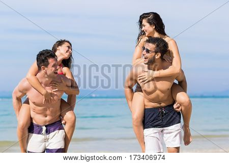Two Couple On Beach Summer Vacation, Young People Happy Smiling, Man Carry Woman Sea Ocean Holiday Travel