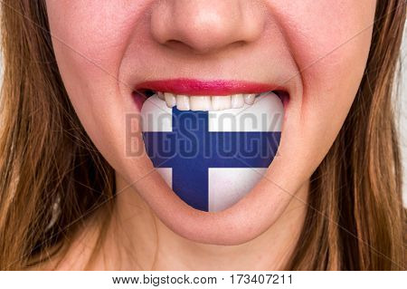 Woman With Finnish Flag On The Tongue