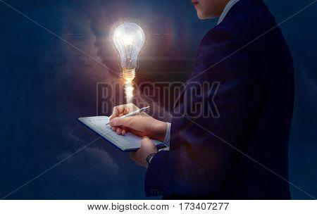 Businessman Writes Down The Idea.