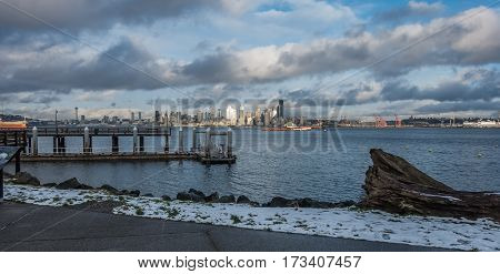 A view of a pier with the Seattle skyline across the water.
