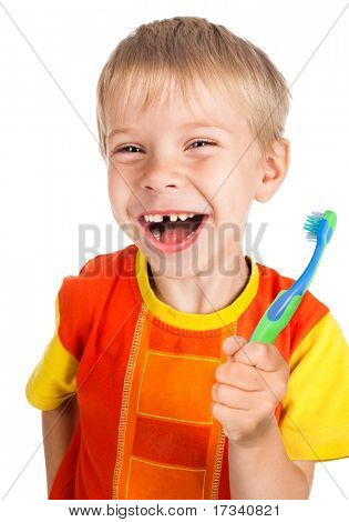 left-handed smiley boy with toothbrush without one tooth isolated on white background