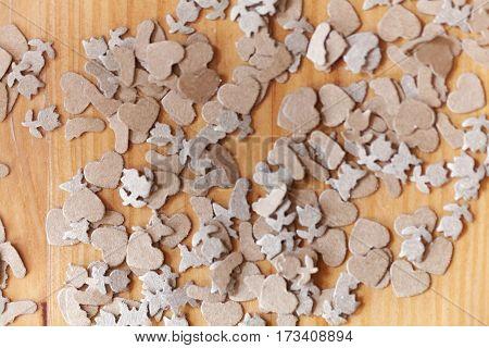 Macro photo of brown paper shavings on wood.