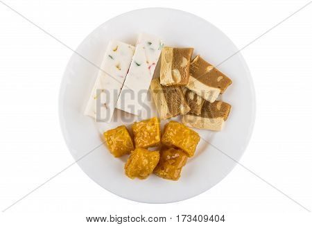 Different Oriental Sweets In Dish Isolated On White