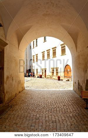 Courtyard of the old medieval fortress of the city Fagaras, Transylvania, Romania.