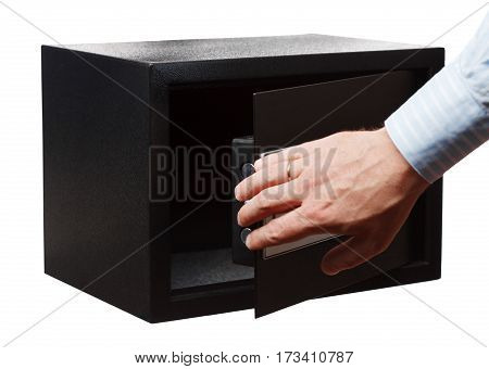 Man's Hand In A Striped Shirt Open Black Safe Isolated On White. Small Home Or Hotel Safe.