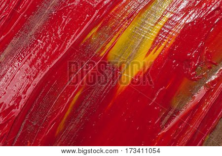 Artists oil paints, colored background. Abstract red splashes and stains