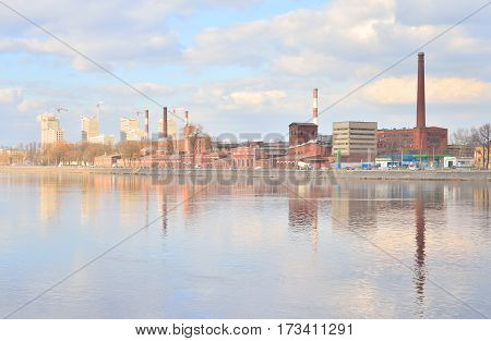 The old factory building and Neva River on the outskirts of St.Petersburg Russia.