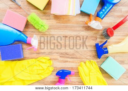 Spring cleaning concept - colorful spays and rubbers frame