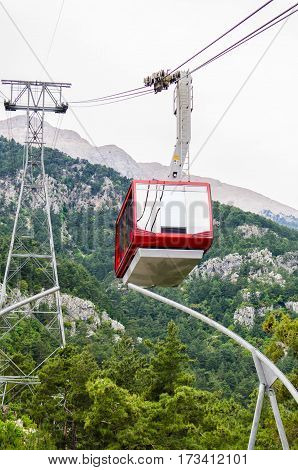 A red cable car ride to the mountaines.