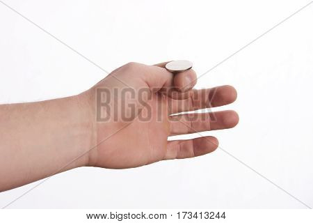 businessman hand throwing up a coin to make decision.heads and tails concept isolated on white
