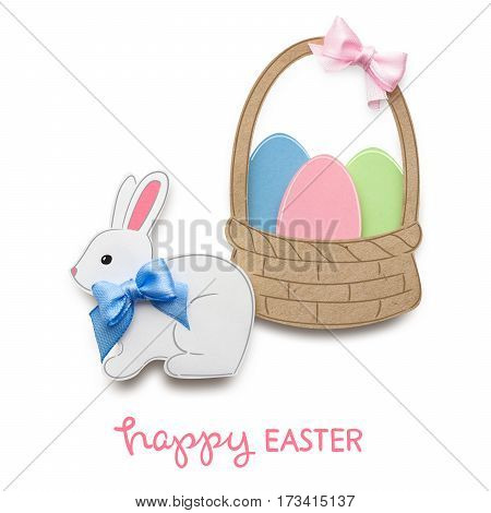Creative easter concept photo of a rabbit with eggs in a basket made of paper on white background.