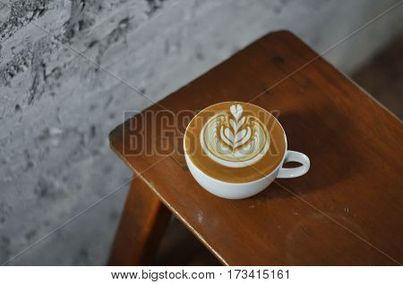 Coffee Cup With Latte Art On The Wood Bench