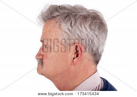 Portrait of a senior man wearing hearing aid. Studio isolated on white background.
