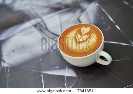 Coffee Cup With Latte Art On The Abstract Background