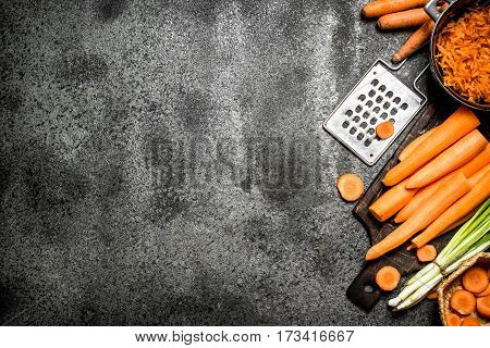 Organic Carrots. On Rustic Background.