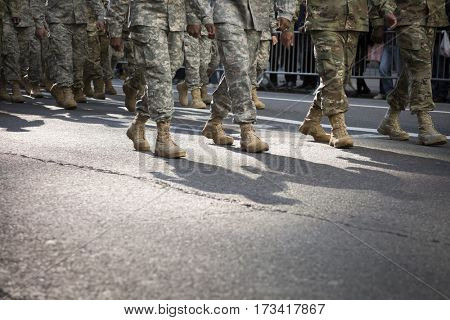 NEW YORK - 11 NOV 2016: Close up of combat boots and camouflage pants of US Army personnel march in Americas Parade up 5th Avenue on Veterans Day in Manhattan.