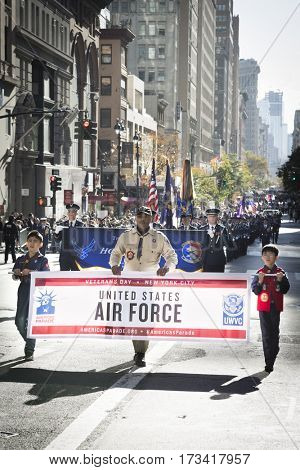 NEW YORK - 11 NOV 2016: Members from Boy Scouts of America hold banner for US Air Force personnel, USAF marching in Americas Parade up 5th Avenue on Veterans Day in Manhattan.