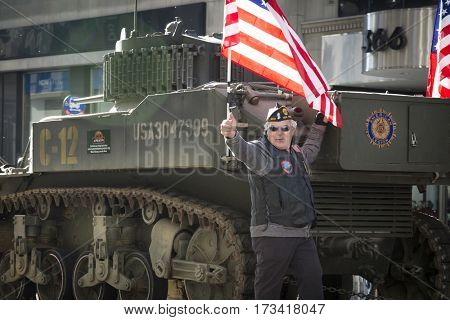 NEW YORK - 11 NOV 2016: Vet gives thumbs up from a parade float in the annual Americas Parade produced by the United War Veterans Council UWVC on 5th Avenue on Veterans Day in Manhattan.