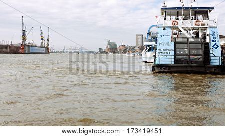 Hamburg, Germany - October, 10, 2016: Passenger touristic ship stays at Hamburg port moorings. View of port dock in a cloudy day. Maritime shipping and transportation concept.