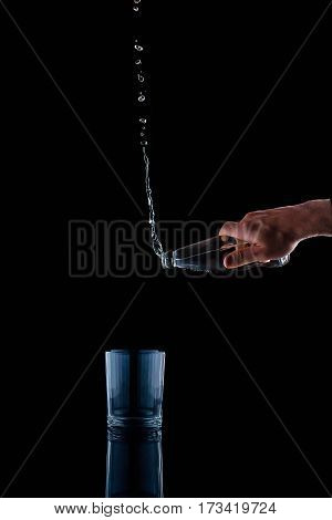 pouring water on a glass on black background drink, mineral, gravitation, gravity