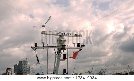 Hamburg, Germany - October, 10, 2016: Ship radar for nautical maritime navigation on the ship top. The seagull is sitting on it.