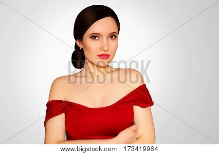 Beautiful girl in a red dress on a light gray background