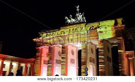 Berlin, Germany - October, 9, 2016: Brandenburg gate the most known landmark in Berlin, Germany. The gate is illuminated and decorated with Bear - the symbol of Berlin.
