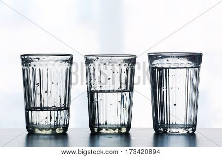 Three glasses with different levels of water