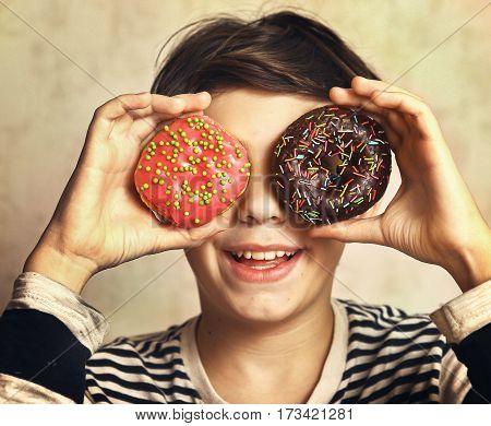 Teen Boy With Doughnuts Eyes Smiling