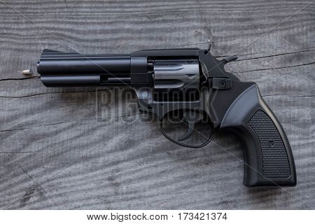 Black Revolver With A Bullet.