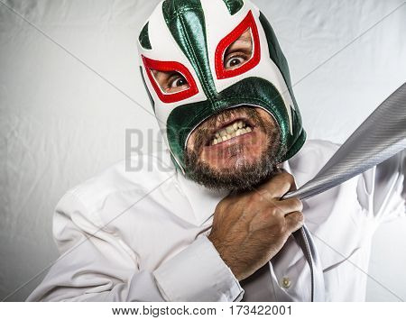 Stress, Angry businessman with iron mask on his face, is dressed in suit and tie