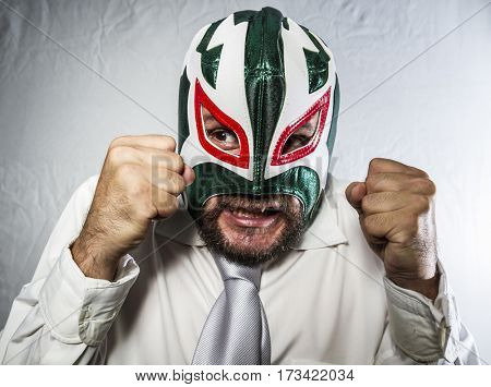 Fury, Angry businessman with iron mask on his face, is dressed in suit and tie