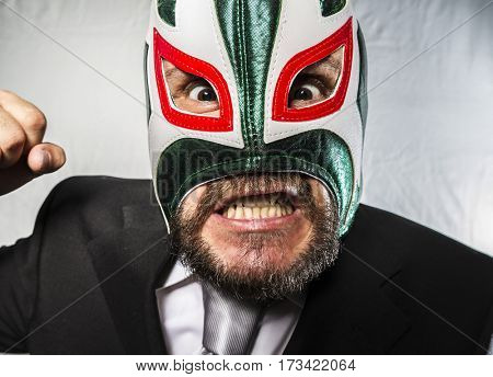 Manager, Angry businessman with iron mask on his face, is dressed in suit and tie