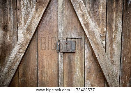 lock and door handle on weathered wooden door, Serbia