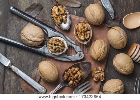 chopped walnuts on a wooden table .